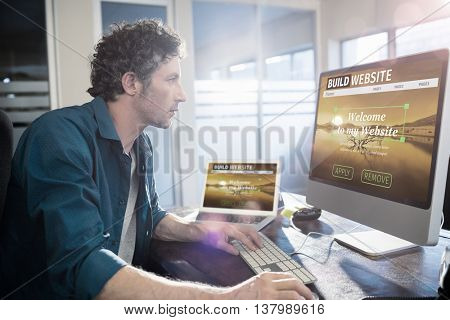 Composite image of build website interface against businessman working on computer Businessman working on computer in office