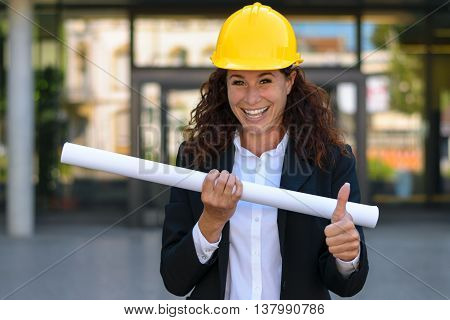 Happy Young Female Architect Giving A Thumbs Up
