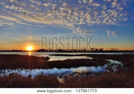 Sunset Over a Marsh and Pond in the Fall