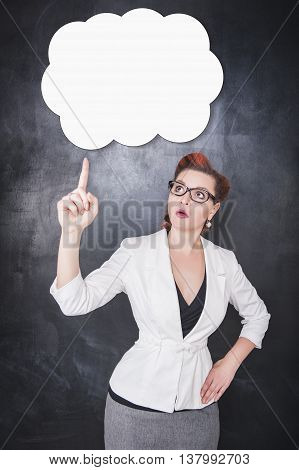 Woman In Glasses Showing On Something By Finger