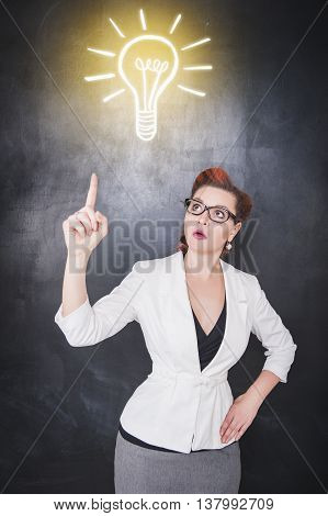 Idea Concept. Woman Showing On Drawing Lamp