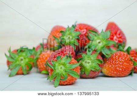 Strawberry fruit with flash filled on wooden board (Also known as Fragaria strawberry Fragaria ananassa)