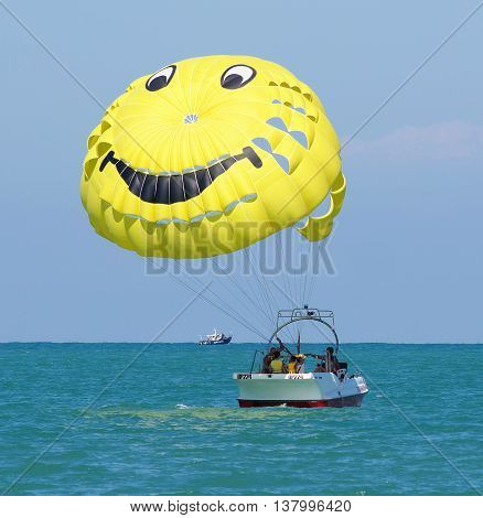 Sochi, Russia - June 24, 2014, People relax on the sea with a parachute on a boat