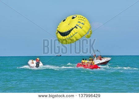 Sochi, Russia - June 24, 2014, Riding along the sea on a boat with a parachute