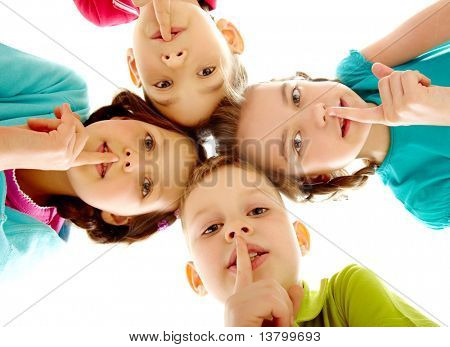 Group of children fingers on lips making silence