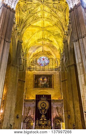SPAIN, SEVILLE - JUNE 4, 2014: Cathedral interior. Catedral de Santa Maria de la Sede - the largest Gothic cathedral in Europe.