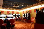 stock photo of slot-machine  - Slot machines in a hall of a casino - JPG