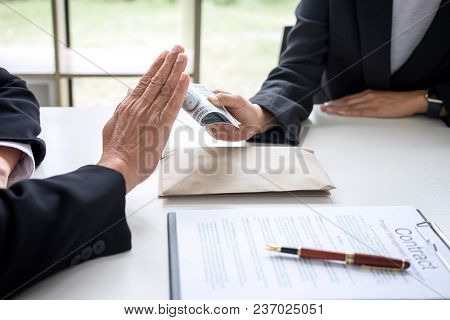 Bribery And Corruption Concept, Senior Businessman Manager Refusing Receive  Money In The Envelope To poster
