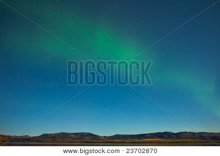 Northern lights and fall colors in moon-lit night