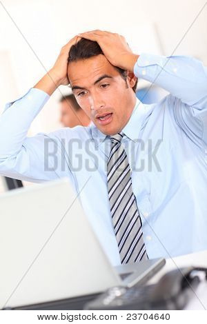 Businessman with shocked look on his face