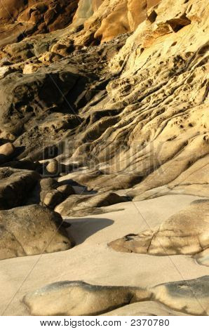 Rocky Beach With Smooth Rock Erosion.