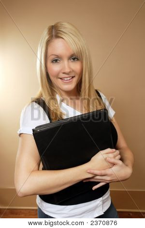 Female Holding Binders Two