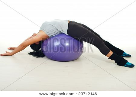 Woman Lying On Pilates Ball