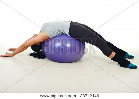 Woman Lying On Pilates Ball