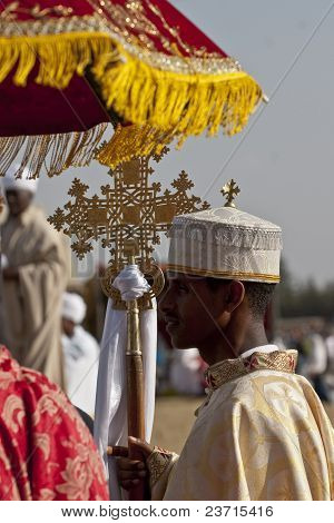 Christian Orthodox devotees holding the Lalibela Cross at the Timket Festival.
