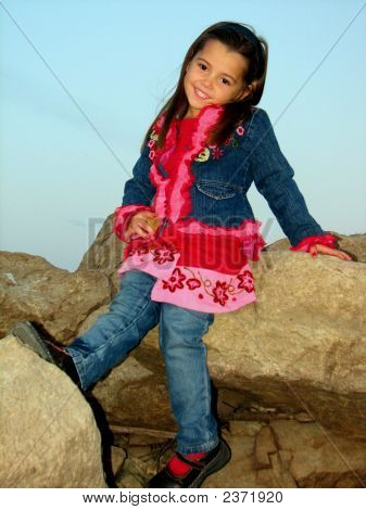 Little Girl Posing On Rocks
