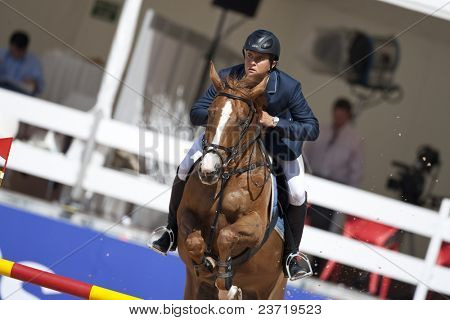 VALENCIA, SPAIN - MAY 8: Rider Amaral Rodrigues, Horse Par Trois, Brazil in the Global Champions Tour Valencia 2010 equestrian - the City of Arts and Sciences of Valencia, Spain on May 8, 2010