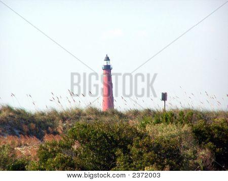 Lighthouse Through The Sea Oats