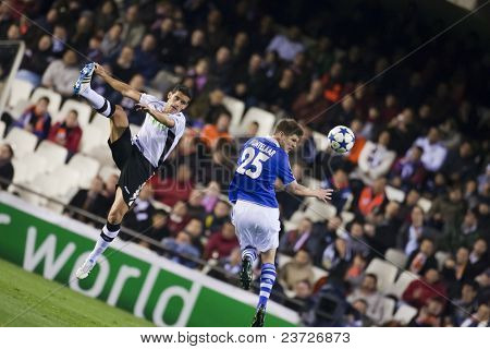 VALENCIA, SPAIN - FEBRUARY 15 - Left Farfan and Banega in the UEFA Champions League between Valencia C.F. vs Schalke 04 - Mestalla Luis Casanova Stadium - Spain on February 15, 2011