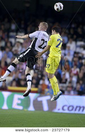 VALENCIA, SPAIN - APRIL 10 - Mathieu and Mario in the Spanish Soccer League between Valencia c.f.. vs Villarreal c.f. - Mestalla Luis Casanova Stadium - Spain on April 10, 2011