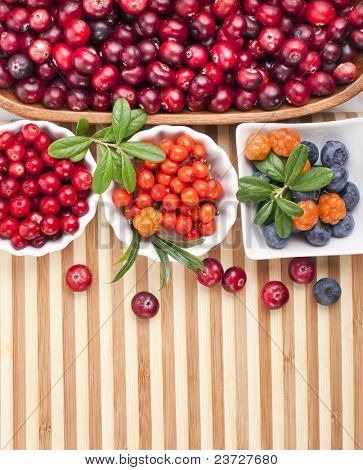 Fresh berries in a  wooden background