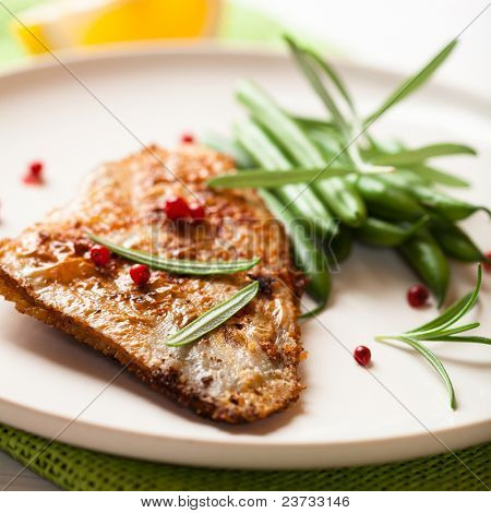 Rustic turbot fillet with green beans and rosemary
