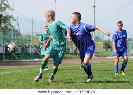 KAPOSVAR, HUNGARY - SEPTEMBER 18: Krisztian Nagy (in green) in action at the Hungarian Championship under 17 game between Kaposvar (green) and Baja (blue) on September 18, 2011 in Kaposvar, Hungary.