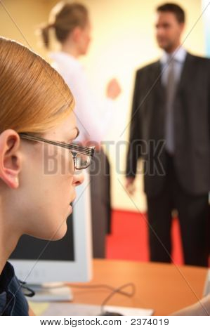 Woman Looks On During A Conversation