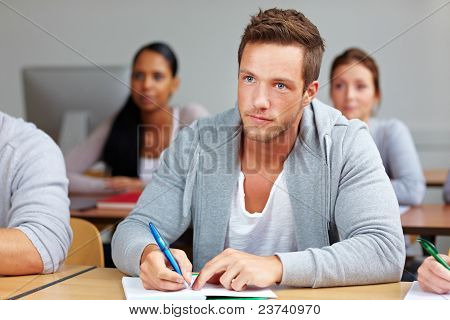 Student Taking Notes In Class