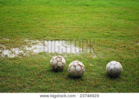 Footballs on a Wet Field