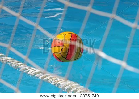 water polo ball through goal net