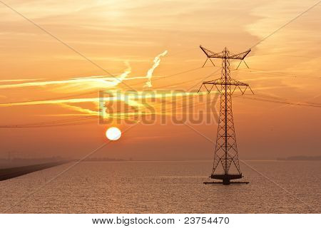 Sunrise Over The Dutch Sea With An Electricity Pylon