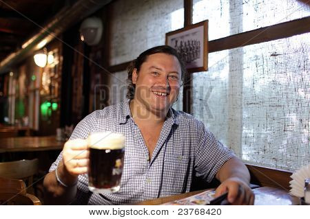 Happy Man With Glass Of Beer