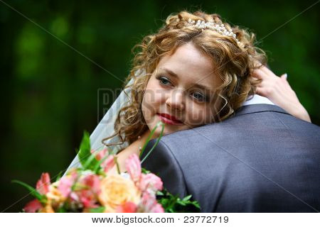 Bride embracing groom