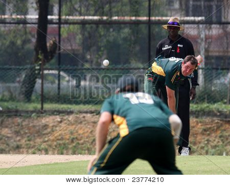 PUCHONG, MALAYSIA - SEPT 24: GM Smit of Guernsey bowls against the Malaysian side at the Pepsi ICC World Cricket League Div 6 finals at the Kinrara Oval on September 24, 2011 in Puchong, Malaysia.