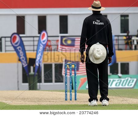 PUCHONG, MALAYSIA- SEPT 24: The umpire views attentively in the Guernsey and Malaysia game in the Pepsi ICC WCL Div 6 finals at the Kinrara Oval on September 24, 2011 in Puchong, Malaysia.