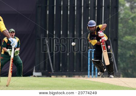 PUCHONG, MALAYSIA- SEPT 24: Faris Lee of Malaysia bats against Guernsey at the Pepsi ICC World Cricket League Div 6 finals at the Kinrara Oval on September 24, 2011 in Puchong, Malaysia. Guernsey won.