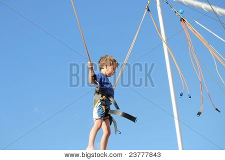 Child Flying High against Blue Sky