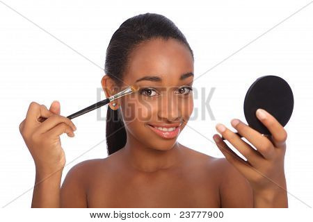 African American Woman Using Eye Shadow Brush