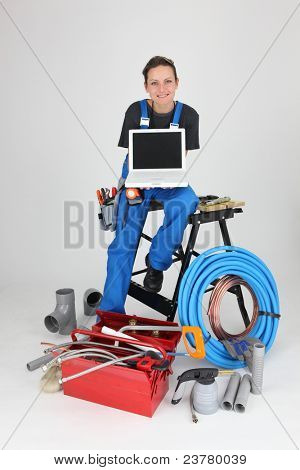 woman plumber showing laptop