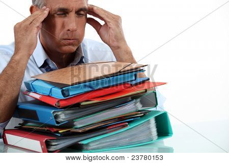Man with stack of work