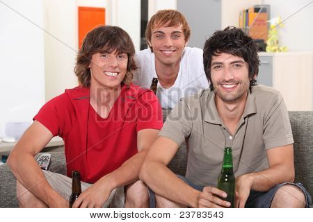 Flatmates enjoying a beer together