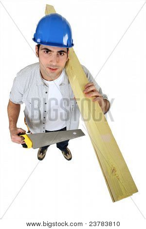 Tradesman holding planks of wood