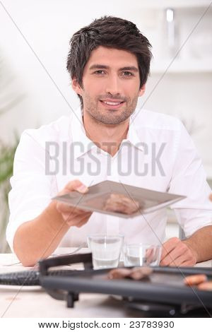 man holding out a plate