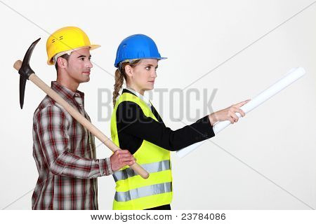 picture of young female architect with male bricklayer