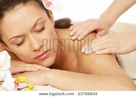 Relaxed young woman at spa salon