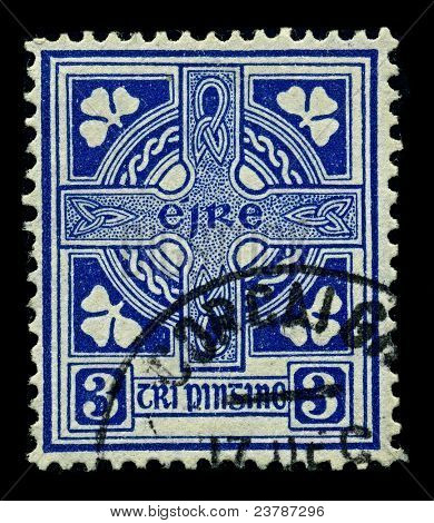 IRELAND-CIRCA 1922: A stamp printed in IRELAND shows image of Celtic cross  is a symbol that combines a cross with a ring surrounding the intersection, circa 1922.