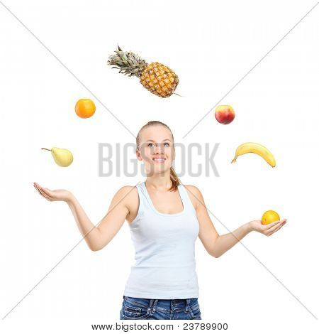 Smiling pretty woman juggling fruits isolated on white background
