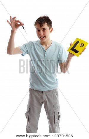 Teenager Holding Car Keys And L Plates