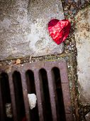 The Broken Heart, Image Of A Crumpled Red Foil On The Floor, Crushed And Broken poster
